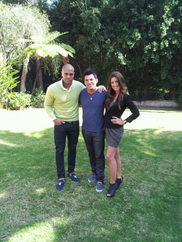 Celebrity Party Planner David Tutera poses with Astor & Black Professional Clothiers Angel Ramos and Tara Gerard.