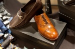 Allen Edmonds dress shoes and sleek, brown cap toes.
