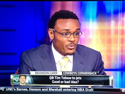 The Dallas Cowboys cornerback, Brandon Carr, answers fan's questions on ESPN, looking dapper in a sleek Astor & Black suit, styled by Astor & Black's Denver clothier, Nicole Brownlie-English.