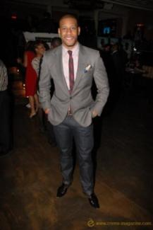 Marketing Consultant, Michael McConnell, looks well put together in his grey Astor & Black suit, cleverly paired with a skinny, navy and red tie, styled by Astor & Black clothier, Jessica Peters, New York.
